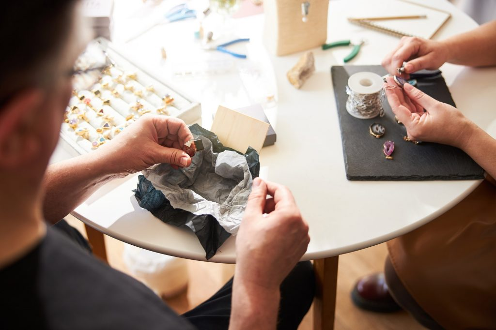 Two experienced jewelers working in their workshop