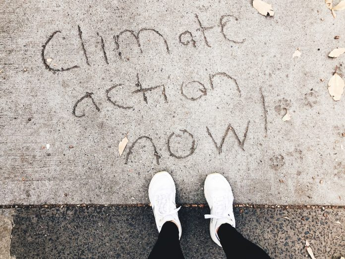 Climate action now writing into he concrete floor